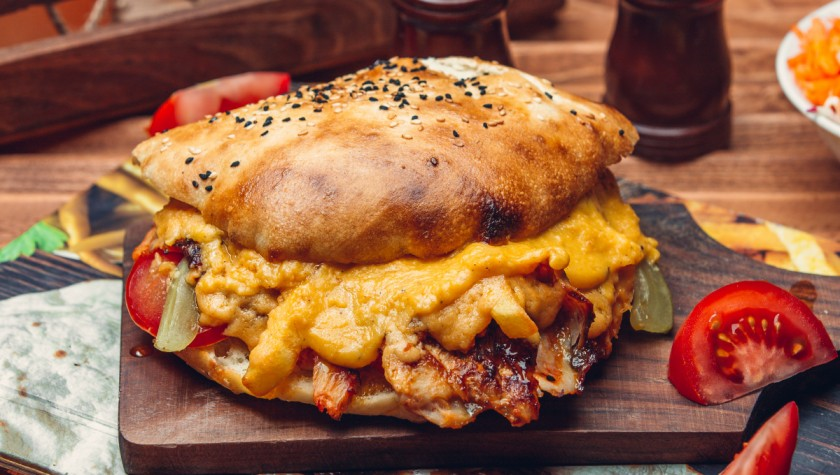 Grilled beef burger with a cheesy layer